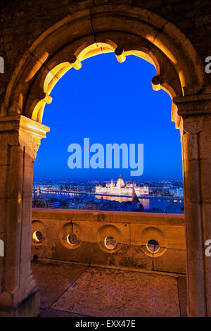 Hungarian Parliament seen through arch of Fisherman's Bastion - Stock Photo