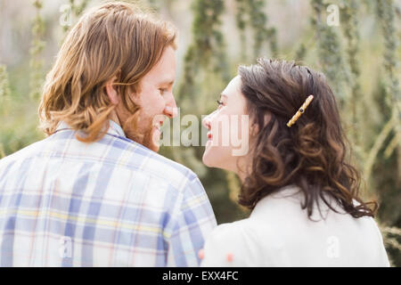 Smiling couple looking at each other - Stock Photo