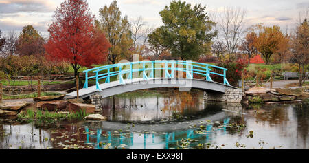 A Pastoral Scene Of A Japanese Foot Bridge Over A Quiet Little Pond On A Rainy Day In Autumn, Southwestern Ohio, - Stock Photo