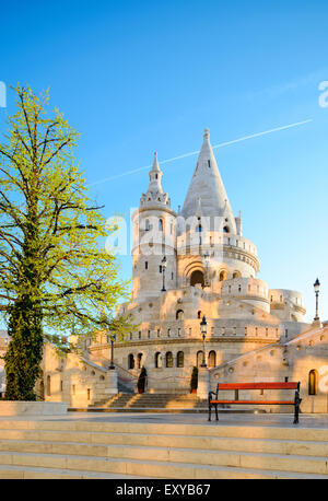 Fishermans Bastion in Budapest, Hungary, early in the morning with spots of sunlight reflected on the stone from - Stock Photo
