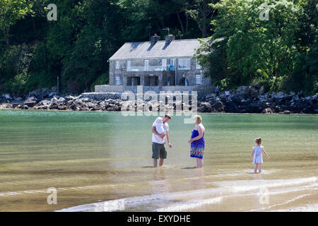 Family in the sea in Barmouth Wales - Stock Photo