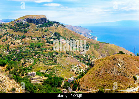 Cape Taormina and view to Letojanni beach, Messina district, Sicily, Italy - Stock Photo