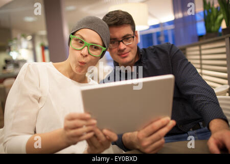 Man and woman wriggle while making selfie - Stock Photo
