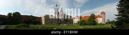 Tourists in front of the Wawel Cathedral and the Royal Palace on Wawel Hill in Krakow, Poland. The panorama has - Stock Photo