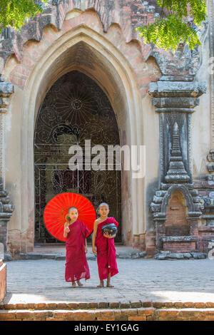 Buddhist novice monks walking at Sulamani Temple, Myanmar - Stock Photo