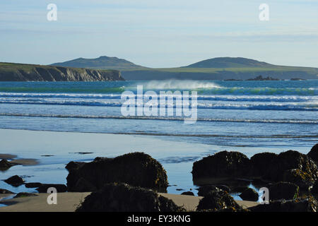 Waves breaking on Whitesands Bay with Ramey Island in background, Pembrokeshire, Wales - Stock Photo