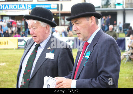 Builth Wells, Powys, Wales, UK. 22nd July 2015. Royal Welsh Show judges with their bowler hats in the cattle ring - Stock Photo