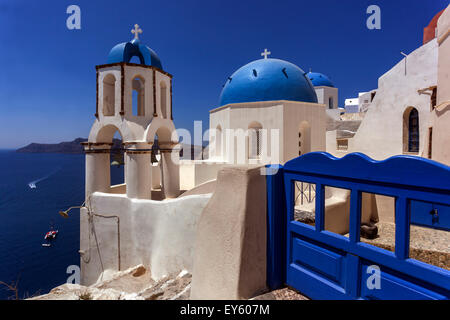 View to the blue domed churches in the Oia village by the cliff, Santorini, Cyclades Islands, Greek Islands, Greece, - Stock Photo