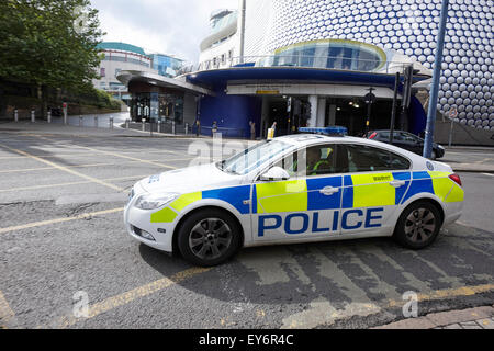 West Midlands police patrol car responding to call out in city centre Birmingham, UK - Stock Photo