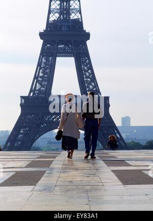 Couple walking toward Eiffel Tower at Palais de Chaillot in Trocadero in Paris - Stock Photo
