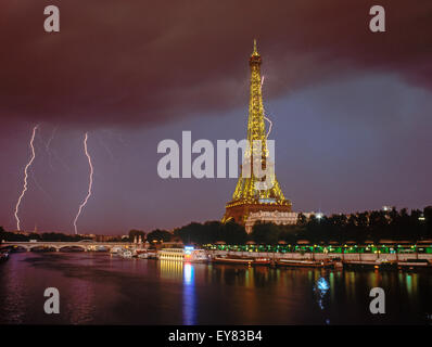 Lightning bolt and storm over Paris at night with Eiffel Tower and River Seine.  This image is not digitally enhanced. - Stock Photo