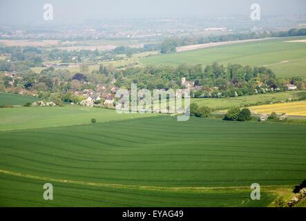 Summer view arable fields to Cherhill village from Cherhill Down escarpment, Wiltshire, England, UK - Stock Photo