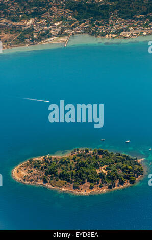 An aerial photo of a little island off Corfu taken from above - Stock Photo
