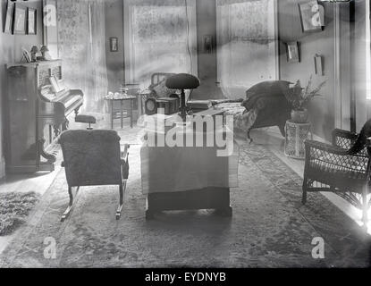 Antique c1910 photograph of a late Victorian, circa 1910s parlor with upright piano and furnishings. See Alamy image - Stock Photo