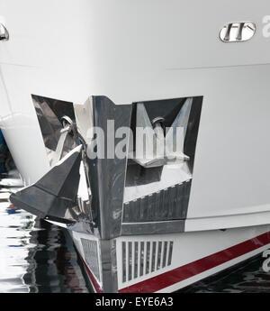 shiny anchor in new ship - Stock Photo