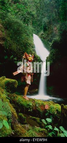 Huli wigman at waterfall near Ambua Lodge, Southern Highland Province; Hela Province, Papua New Guinea - Stock Photo
