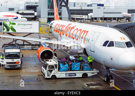 Easyjet plane being loaded with luggage at Gatwick airport, London, England, UK - Stock Photo