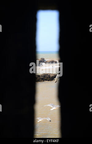 View of the Atlantic ocean from a window in the fortified tower at the Skala de la Ville, Essaouira, Morocco - Stock Photo