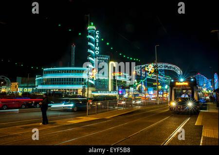 Colourful lights illuminate a tourist area; Blackpool, Lancashire, England - Stock Photo