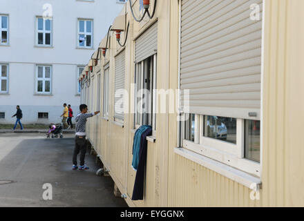 Trier, Germany. 29th July, 2015. A man stands in front of a residential container on the premises of the reception - Stock Photo