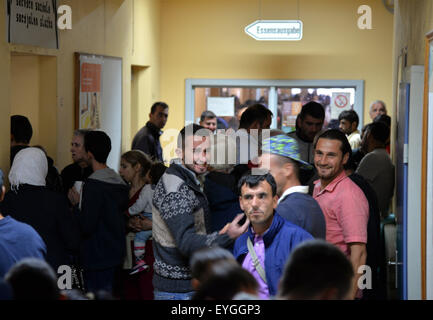 Trier, Germany. 29th July, 2015. Crowds of people queue up for food in the reception facility for asylum seekers - Stock Photo