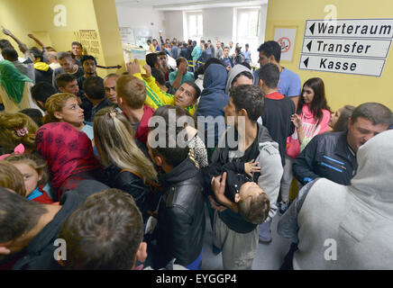 Trier, Germany. 29th July, 2015. Crowds of people wait in the reception facility for asylum seekers in Trier, Germany, - Stock Photo