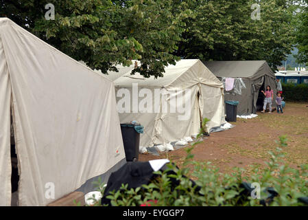 Trier, Germany. 29th July, 2015. Provisional tents stand on the premises of the reception facility for asylum seekers - Stock Photo
