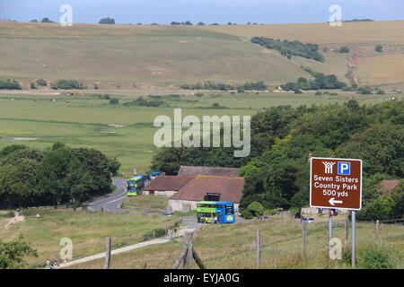SEVEN SISTERS COUNTRY PARK ON THE SOUTH DOWNS AT EXCEAT WITH BRIGHTON & HOVE COASTER BUSES IN VIEW - Stock Photo