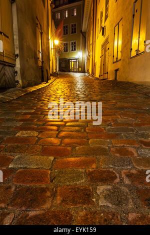 Tallinn Old Town street with cobblestones in night, Estonia - Stock Photo