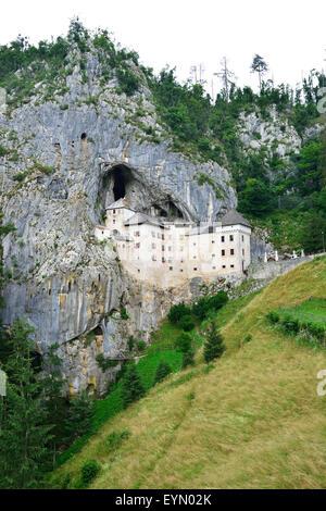 CASTLE IN CLIFF. Predjama Castle, Predjamski, Inner Carniola, Slovenia. - Stock Photo
