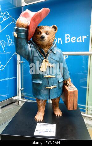A statue of Paddington Bear at Paddington Station, London, England, UK - Stock Photo