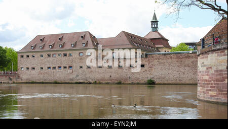 Old architecture by the river Ill in the Petite France district of Strasbourg, capital of the Alsace region in France. - Stock Photo