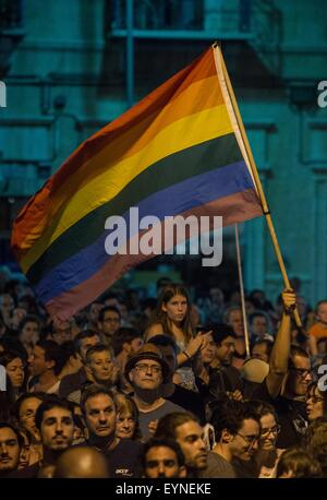 (150801) -- JERUSALEM, Aug. 1, 2015 (Xinhua) -- A man waves a rainbow flag during a rally against the violence and - Stock Photo