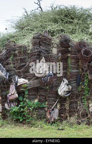 Display of wire snares and backpacks collected from poachers in Hlane National Park, Swaziland - Stock Photo