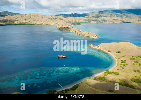 The view from the top of the mountain in North Komodo National Park overlooking the beautiful turquoise bay - Stock Photo