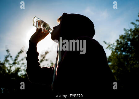 Teenager with Vodka. - Stock Photo