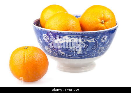 Oranges in a beautiful ancient  porcelain hand-painted bowl - Stock Photo