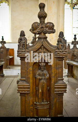 Carved wooden church pews - Stock Photo