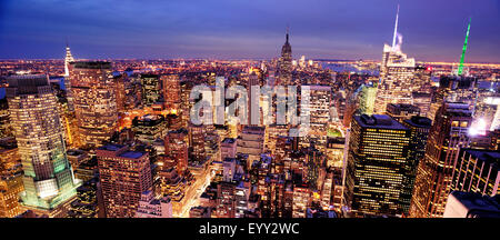 Aerial view of highrise buildings in cityscape at twilight - Stock Photo