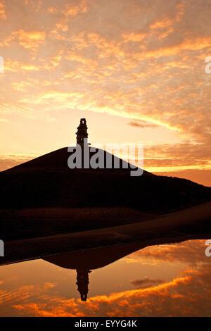 artwork 'stairway to heaven' on stuck pile Rheinelbe mirroring in a pond at sunset, Germany, North Rhine-Westphalia, - Stock Photo