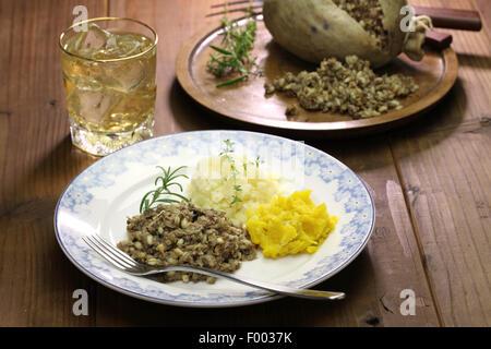 haggis neeps tatties and scotch whisky, scotland traditional food - Stock Photo