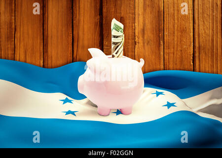 Composite image of dollar in piggy bank - Stock Photo