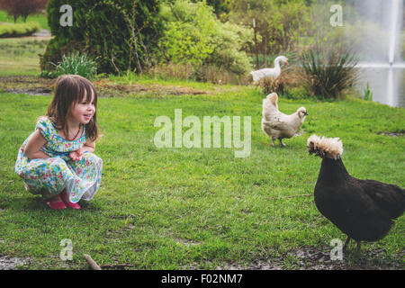 Girl with two chickens and a goose - Stock Photo