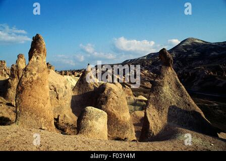 The so-called Fairy Chimneys, pyramidal tuff formations, Zelve, Goreme Valley (Unesco World Heritage List, 1985), - Stock Photo