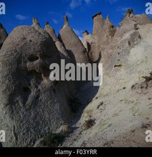 The so-called Fairy Chimneys, pyramidal tuff formations, Cappadocia, Turkey. - Stock Photo