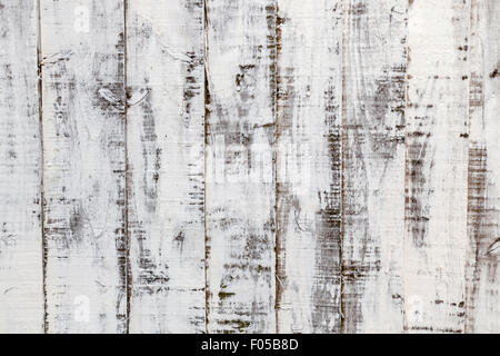 Weathered wood background: distressed paint on an old wooden fence - Stock Photo