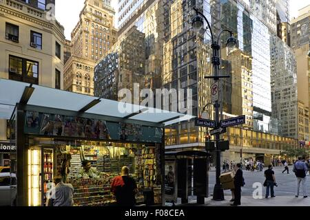 People on 42nd street and skyscrapers in background, New York, USA - Stock Photo