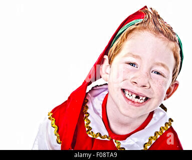 Cute boy in a Christmas Elf costume - Stock Photo
