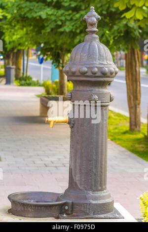 Public drinking water tap on street - Stock Photo
