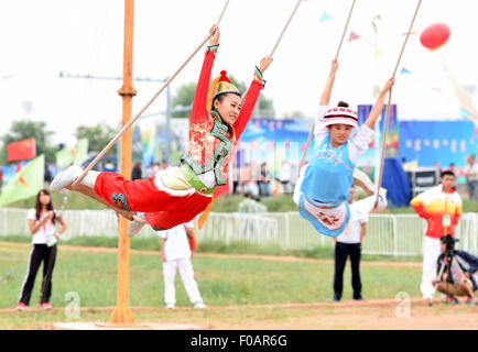 Ordos, China's Inner Mongolia Autonomous Region. 11th Aug, 2015. Athletes from north China's Hebei Province perform - Stock Photo